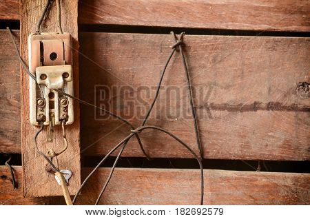 Old Electrical Equipment In Vintage Light On Wood Wall
