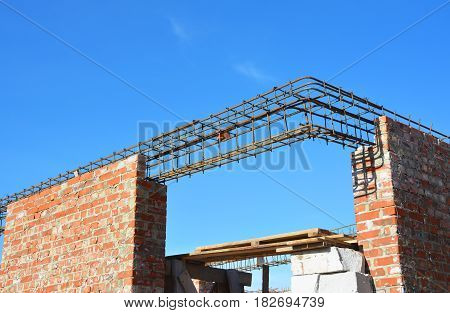 Lintel Construction. Rebar steel bars on new home construction corner reinforcement concrete bars with wire rod as a lintel for window. Brickwork with Iron Bars