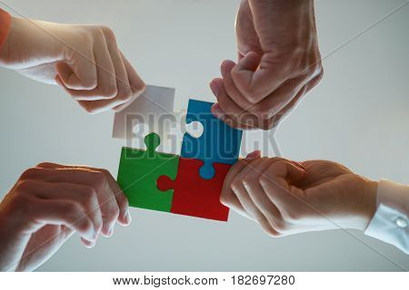 Business People Jigsaw Puzzle Collaboration Team Concept.