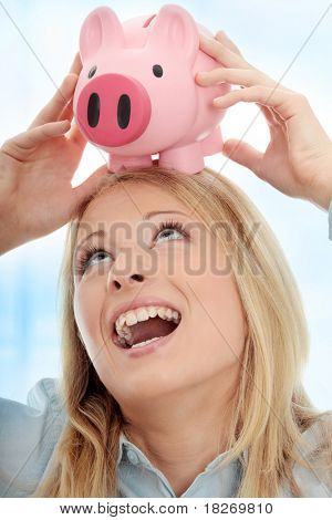 Businesswoman holding piggy bank. Over abstract blue background