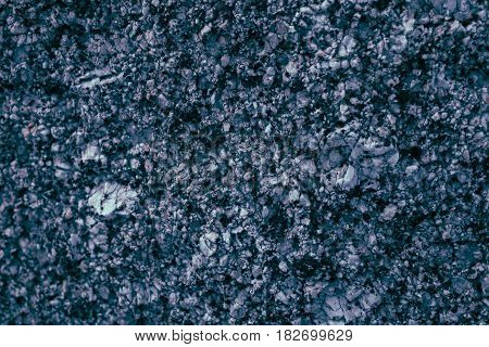 Rough abstract grey texture. Rough stone texture and background. Natural pattern. Abstract texture and background for designers. Macro and close up view of solid rock texture. Volcanic stone.
