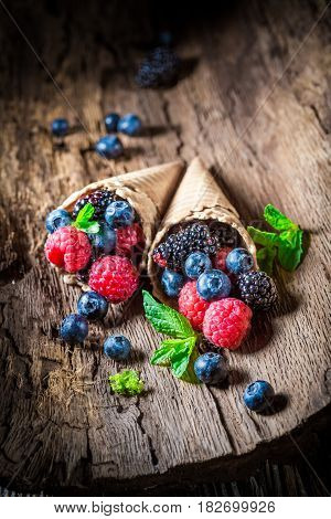 Closeup Of Berry Fruits Ice Cream In Waffels As Concept