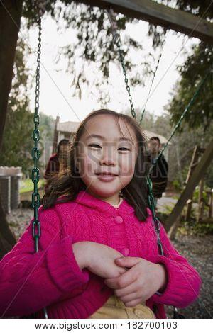 Korean girl swinging