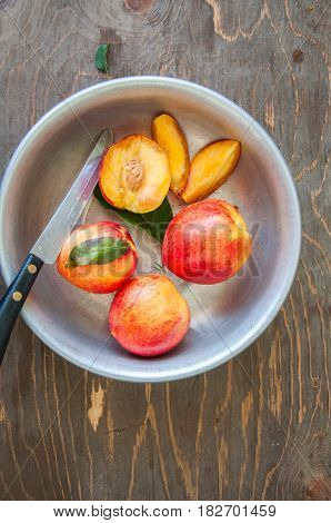 Close Up Of Whole And Slices Of Fresh Ripe Honeyed Nectarines (peaches) With Leaves And Water Drops