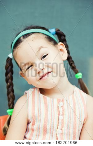 Little pretty, girl with pigtails. Mix face