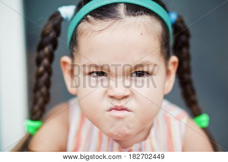 Offended little girl. Little girl with pigtails