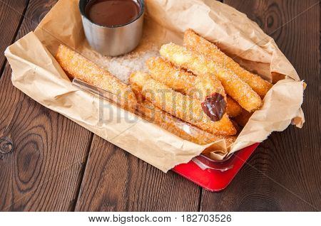 Traditional Spanish Treat. Popular Street Food - Churros Sprinkled With Sugar And Cinnamon With Hot