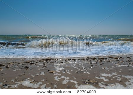 Sea tide beautiful turquoise sea wave and gently blue sky