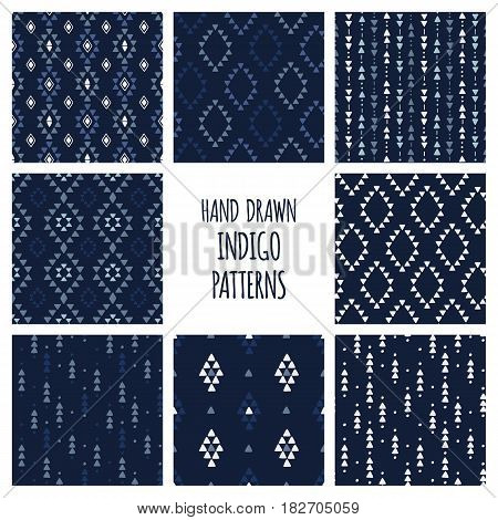 Set of hand drawn indigo blue patterns. Seamless tribal indian backgrounds with triangles, arrows, rhombuses and diamonds. Vector illustration.