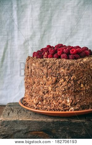 Close Up Of High Delicious Chocolate Honey Cake With Nuts And Cream Cheese Ganache Garnished With Cr