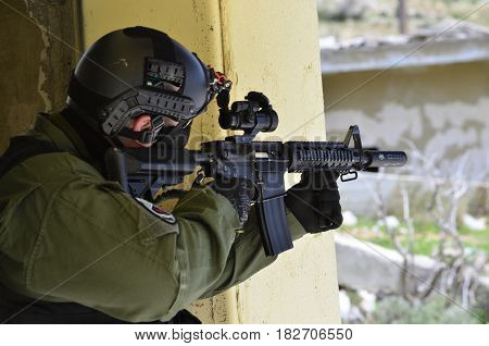 Special forces soldier aim target with sub machine gun