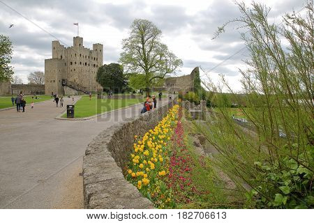 ROCHESTER, UK - APRIL 14, 2017: View of the Castle from the Esplanade on the Castle Hill with Spring colors