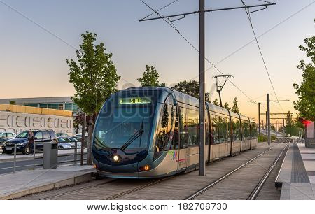 Bordeaux, France - April 8, 2017: Alstom Citadis 302 tram at Palais des Congres station. Bordeaux tram system has 66 km of lines and 116 stations