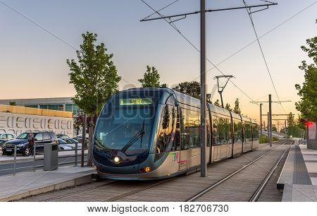 Bordeaux, France - April 8, 2017: Alstom Citadis 302 tram at Palais des Congres station. Bordeaux tram system has 66 km of lines and 116 stations