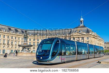 Bordeaux, France - April 8, 2017: Alstom Citadis 302 tram at Place de la Bourse station. Bordeaux tram system has 66 km of lines and 116 stations