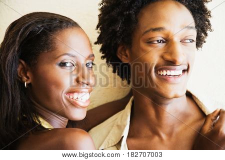 African couple hugging and smiling