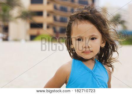 Mixed race girl on beach