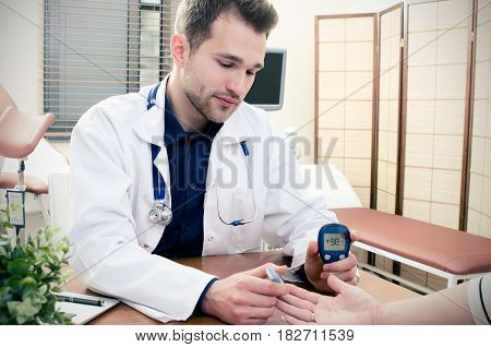 Doctor Measuring Of Blood Sugar For Diabetes Patient.