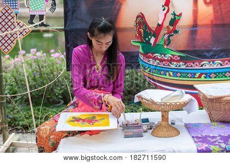BANGKOK THAILAND - APRIL 8-15 2017 : Songkran festival of Thailand Close up of hand painting batik on April 8 2014 at Siam-Center in Bangkok
