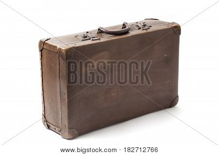 Closed obsolete antiquated and used suitcase stands isolated on white background.