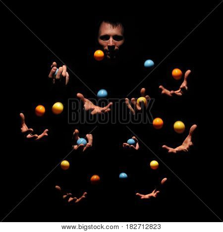 Talented man juggling with color balls. Successful concept. Caucasian performer show exhibition.