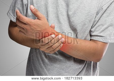 People has pain in hand Men with wrist problem concept isolate on white background