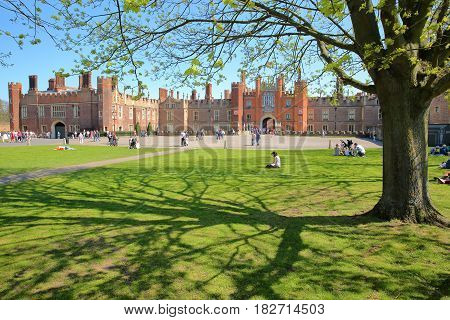 LONDON, UK - APRIL 9, 2017: The West front and main entrance of Hampton Court Palace in Southwest London