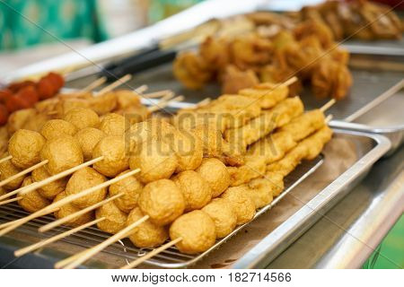 Malaysian fried chicken on a skewer .