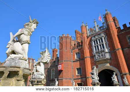 LONDON, UK - APRIL 9, 2017: The West front and main entrance of Hampton Court Palace in Southwest London with details of dragon statues