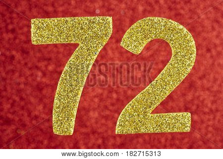 Number seventy-two yellow color over a red background. Anniversary. Horizontal