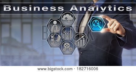 Blue chip corporate manager is gaining insight into business performance by focusing on a virtual planning matrix with Business Analytics tools. Business concept for applied data mining and big data.