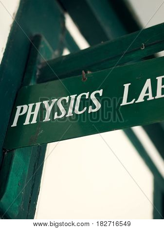 COLOR PHOTO OF BOARD WITH 'PHYSICS LAB' SIGN