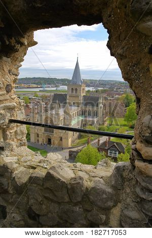 ROCHESTER, UK - APRIL 14, 2017: View of the Cathedral through the Castle walls