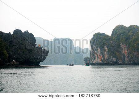 Halong Bay Vietnam - March 7 2017: travel boats near Cat Ba island Halong Bay Vietnam