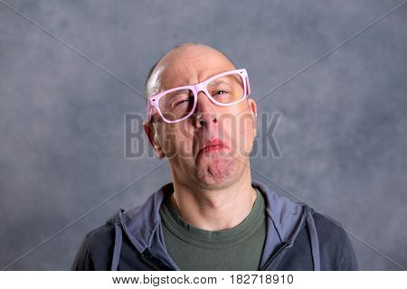 Funny Baldheaded Man With Pink Glasses