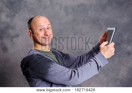 Young Man Using Tablet Computer