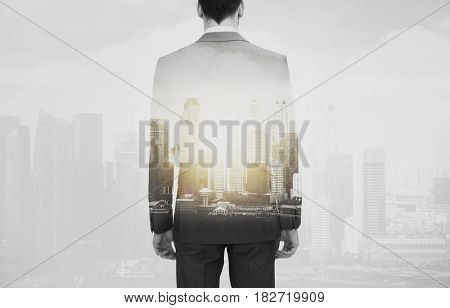 business and people concept - close up of businessman in suit from back over city buildings and double exposure effect