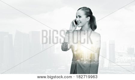 business, technology, communication and people concept - smiling businesswoman calling on smartphone over city buildings and double exposure effect