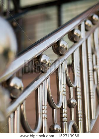 COLOR PHOTO OF HANDRAIL MADE FROM STAINLESS STEEL