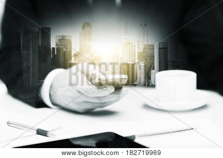 business, technology and people concept - businessman with smartphone and coffee at office over city buildings and double exposure effect
