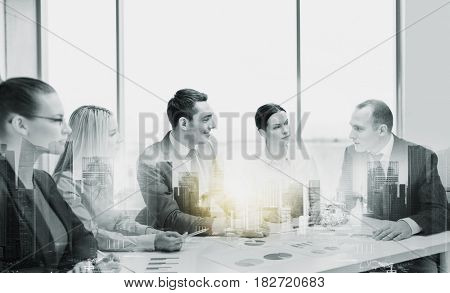 business, teamwork and people concept - team at office meeting over city buildings and double exposure effect