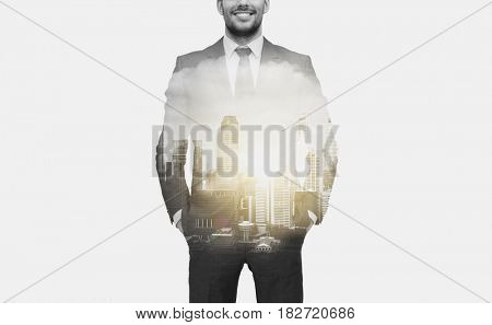 business and people concept - close up of businessman in suit over city buildings and double exposure effect