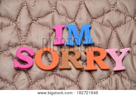word im sorry on a  abstract colorful background