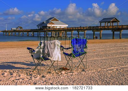Beach chairs near pier 60 at Clearwater Beach at sunrise