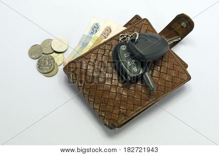 wallet, banknotes, coins and car key FOB