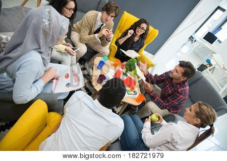 Shot of a group of young business professionals having a meeting. Diverse group of young designers smiling during a meeting at the office.