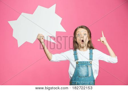 Adorable Little Girl Holding Blank Speech Bubble And Pointing Up With Finger