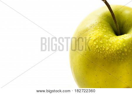 Fresh green apple on the side, isolated on white