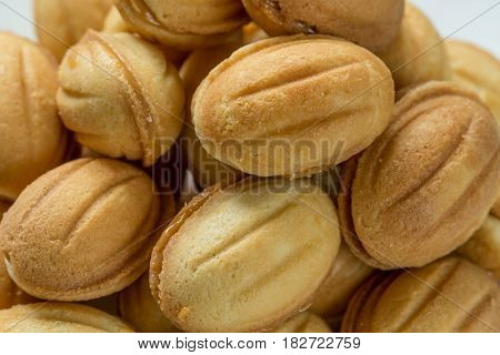 Pile of cookies with boiled condenced milk, close-up