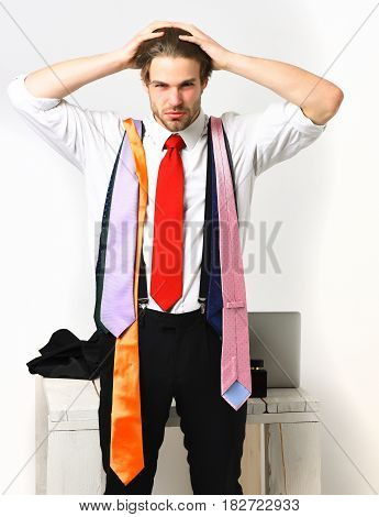 Bearded Macho Man With Colorful Ties Isolated On White